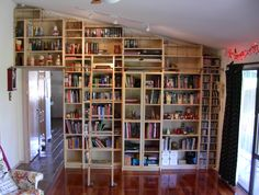 Our Ikea Hack Billy Bookcase Library Wall With Home Made Rolling Ladder