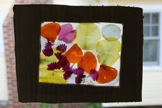 stained glass flower viewer- here is a simplified FLAT version, like a picture frame, instead of a 3D box. very pretty!  *http://www.artfulparent.com/2011/05/our-flower-petal-art-box.html