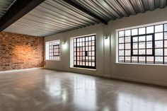 Riflemaker is a pre-war building, once the home to some of Birmingham's original gunsmiths. It was converted in 2014 into six through-floor loft apartments. Brick Interior, Reuse Recycle, City Living, Exposed Brick, Birmingham, Industrial Design, Repurposed, Gun, Garage Doors