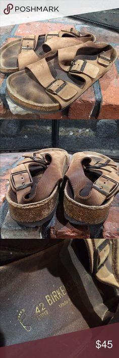 Birkenstock men's sandals size 42 Birkenstock men's sandals size 42.  Well loved adjustable strap sandals.  Some fading and wear as shown in pictures. Birkenstock Shoes Sandals & Flip-Flops