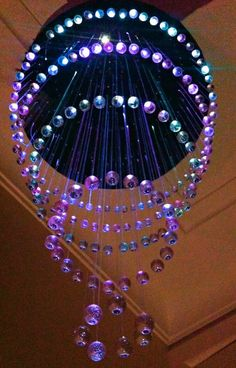 LED Fibre Optic Chandelier DIY by mackintoshlinessless on Instructables. This is a complex build, but several of his solution steps are intriguing!
