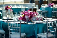 Fuschia centerpiece with teal table linen and silver chivari chairs