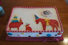 Invitation matching red and white animal themed birthday sheet cake with colorful polka dots