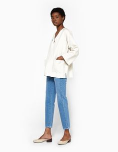 Vintage-inspired jeans from NEED in Isla. Medium wash. High rise. Zip fly with top button closure. Classic five-pocket styling. Satin-finished silvertone buttons and rivets. Back yoke. Gently tapered leg. White topstitching. Full length.  • Stretch deni