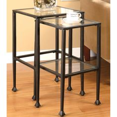 This two piece nesting table is a functional and fashion friendly set for any home. The elegant metal and glass construction adds a classic accent to your decor.