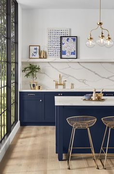 Love this kitchen cabinet color - deep blues are definitely a trending color! #paint #paintcolors #bluepaint