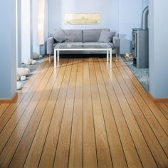brown hardwood flooring and gray sofa design in living room for home and advice for home furniture and home decoration 4 Grey Sofa Design, Gray Sofa, Wooden Flooring, Hardwood Floors, Floor Rugs, Tile Floor, Double Vitrage, Wood Cladding, Floor Design
