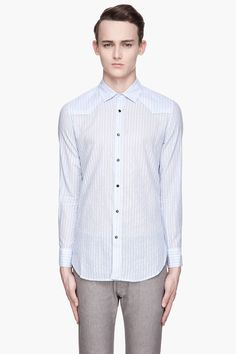 DIESEL // PASTEL BLUE AND METALLIC SILVER SISALIKO SHIRT 31001M040018  Long sleeve shirt in pastel blue. White pinstripes throughout with metallic silver accent thread. Spread collar. Press-stud closure at front. Shirttail hem. Tonal stitching. Three press studs at barrel cuffs with buttoned sleeve placket. 99% cotton, 1% other fibers. Machine wash cold. Imported. Man Shirt, Pastel Blue, Diesel, Barrel, Studs, Long Sleeve Shirts, Stitching, Cuffs, Metallic