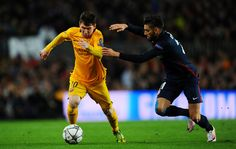 Lionel Messi of Barcelona is chased by Yannick Carrasco of Atletico Madrid during the UEFA Champions League quarter final first leg match between FC Barcelona and Club Atletico de Madrid at Camp Nou on April 5, 2016 in Barcelona