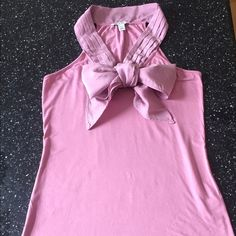 Beautiful pink Banana Republic Dana top. Stretchy fabric with silk bow tie collar. Beautiful alone or under a blazer. EUC Banana Republic Tops Tank Tops