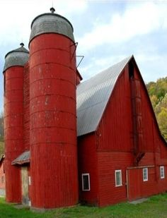 red barn with red silos