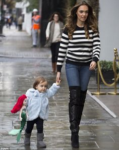 Quality time: Tamara Ecclestone was pictured carrying her 20-month-old daughter to her Sho...