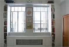 bookcase is too, too skinny but I like how they worked the heating unit underneath the window.