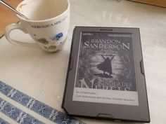 """Kerstin R shares her : """"I'm reading Brandon Sanderson's """"Mistborn"""" those days :-) (and apparently my coffee is gone)"""" Brandon Sanderson Mistborn, Community Boards, My Coffee, Invitations, Reading, Day, Children, My Coffee Shop, Reading Books"""