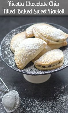 Baked Sweet Ravioli, a delicious flakey pastry stuffed with a lightly sweetened Ricotta filling and baked to perfection. The perfect after dinner dessert or snack. #ravioli #dessert #ricotta #italian