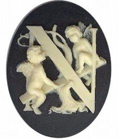 "Item#150x Acrylic 40x30 black/ivory letter ""N"" cameo"