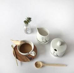 hand made espresso cup and sustainable wooden saucer with black branch design shop online at love milo south africa