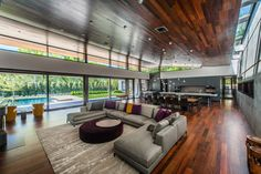 "Large central ""hearth room"" has a mostly glass wall facing the outdoor pool and living area with a ceiling clad in ipe wood above a continuous skylight in this home in Nashville Tennessee. [2364  1573] http://ift.tt/2kXGNkR"