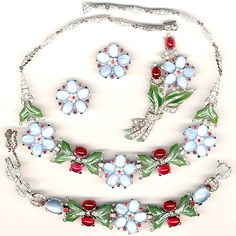 Trifari 'Alfred Philippe' Blue Moonstone Flowers, Ruby Berries, and Enamelled Leaves Necklace, Bracelet, Pin Clip and Clip Earrings Set, c. 1942