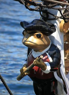 Frog-sailor, a ridiculously adorable and whimsical ship's masthead. He looks as though he takes his duties quite seriously and he's a natty little dresser to boot! | Tall Ships, Halifax, Nova Scotia