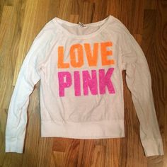 PINK Victoria Secret long sleeve top Size XS, long sleeve Pink Victoria Secret shirt. Orange and pink sparkle/sequins writing. PINK Victoria's Secret Tops Tees - Long Sleeve