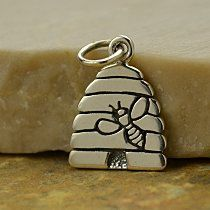 Sterling Silver Etched Bee and Beehive Charm. With fine detailed etching onto a flat plate, an adorable bee and its hive come to life! This charm is perfect for adding a touch of whimsy into jewelry. . Measurements (mm): Length: 16.6 Width: 10.3 Height: 1
