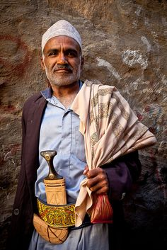 portrait of a man with his Jambiya and his bag of qat-the historical center of ibb-yemen