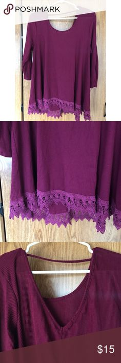 Dark purple top with open back and lace trim. Long purple top with an open back and lace trim on the bottom is very soft and comfortable. Has 3/4 sleeves. You and dress the up or down. Great with leggings and boots. Maurices Tops