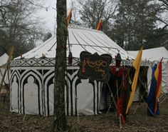 Revival Clothing - I love the design painted on this tent.  The continuous diamond-exes (crossed lines) with circles is within my artistic ability.