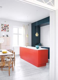 Orange red, tomato red kitchen island and dark teal coloured cabinets paired up . Orange red, tomato red kitchen island and dark teal coloured cabinets paired up against a powder coloured freestanding cabinet, the base is kept white in the apartment. Apartment Kitchen, Home Decor Kitchen, Kitchen Interior, Home Interior Design, Diy Kitchen, The Apartment, Kitchen Ideas, Interior Plants, Kitchen Trends
