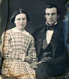 Unknown photographer, daguerreotype of a married couple, c.1855. love her hair and the dress!