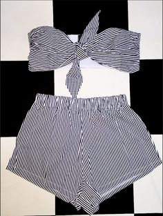 Throwing back to tha 70s. The Heidi 2 piece ft. a tie front bustier top and easy short. These are the perfect summer 2 pieces. Wear them together or separately, or you could throw a denim jacket over. Whatever. We'll leave it to you to work your magic. We suggest you pair these with high socks and sneakers or roller skates or ....... just go bare foot. Polyester blend Lightweight Elastic waist band