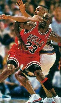 In a class UNC versus Duke battle legendary Tarheel the GOAT Michael Jordan battles to deny post position to legendary Blue Devil Grant Hill in Detroit.