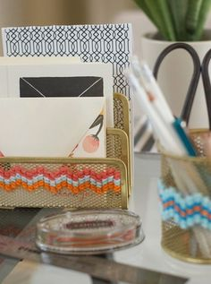 Cross Stitch If you already have wire office organizers but just want to spice them up a bit, you can cross stitch the fronts with yarn.