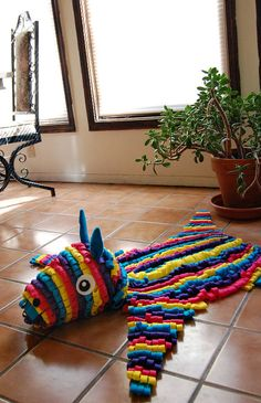 Brighten up a room with this handmade pinata rug!
