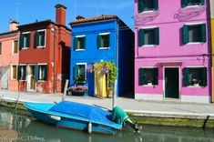 Variety of colors at a Burano canal, Italy - Learn more about colorful Burano island in my article!
