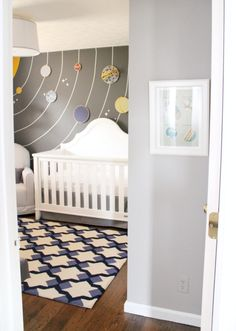 Idea for the wall in 'big boy' room. Note the planets are made from embroidery frames hung on the wall. Love that.