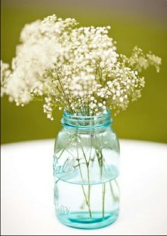 Love this simple center piece, mason jar and baby's breath