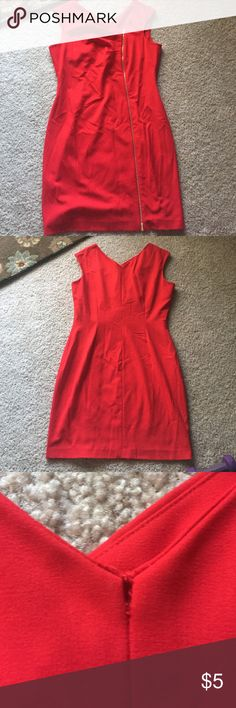 Red dress Very nice red dress ~ very small but repairable rip at the sewing seam on upper area of neck area~ please view picture  the exact size is not known I'd say a size 10 Approx knee length Calvin Klein Dresses High Low