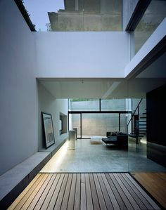 white walls and wood / concrete floors