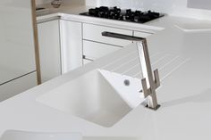 Rotpunkt Dia White High Gloss Kitchens: Another pic from our High Gloss Rotpunkt display, showing off the acrylic worktops and there seamless joints to the sink bowl. A perfect worktop for this style of kitchen.