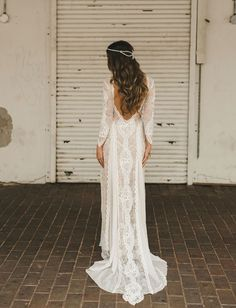 A simple laced white dress to fit the rustic style.