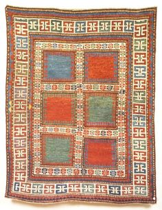 "Antique Karachov Kazak rug, Karachov district, Kazak region, N.W. Azerbadjian (The Caucasus), 2nd half 19th C This rug belongs to a rare group of plain field Kazaks, the most desirable type being the ""Three field"" (ref. Rippon Boswell, Wiesbaden, Nov 1991, Lot 42, also E Herrmann, Seltene Orientteppiche VIII, Munich, 1986, Lot 29). This example with six plain spaces is equally stunning in its simplicity, with the single blue panel adding interest.  5'7"" x 4'5"" Sold for 13,500 Euros Oct 2006"