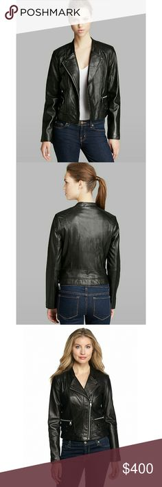 New! Andrew Marc New York Black Leather Jacket You can still look stylish as the weather cools down in this Andrew Marc's Marc New York Leather jacket. Wear it over all of your favorite outfits for a trend-right finish.   100% Genuine leather moto jacket  Asymmetric full front-zip closure  Double snap tab detail at sides  Side hand pockets with zipper closure  Long set-in sleeves  Fully lined  100% leather  Body Lining: 100% cotton; Sleeve Lining: 100% polyester  Professional leather dry…