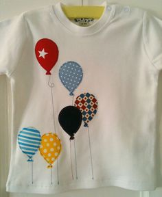 Boy Balloon appliqued organic T-shirt toddler sizes in bright blues and patterns.