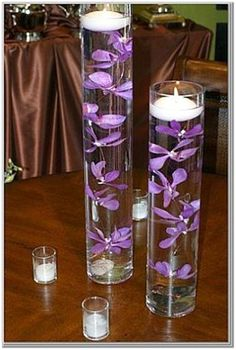 floating candles with submerged purple flowers.. maybe in white or pink?