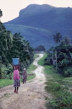 Looks like the road from our house into the village of Nsawam, Ghana.  (But its Volta region of Ghana in West Africa)
