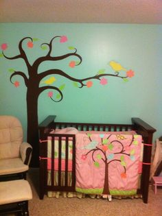 I drew this, free-hand, then painted it on my friend's wall in her Baby Girl's room.