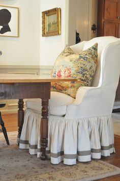 Love wingback chair cover and LOVE pillow Now this is how I envision a dining room table.two comfy wingback chairs at either end and a mix of others on either side of a distressed wood table. Great slipcover job on the chair! Dining Room Table Chairs, Dining Chair Slipcovers, Wingback Chairs, Wood Table, Armchairs, Shabby, Fresh Farmhouse, Farmhouse Style, Farmhouse Design
