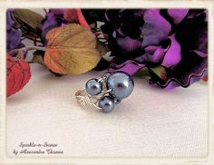 """The Elyse Ring - Spin your troubles away with this fun and elegant ring containing Swarovski crystal dark gray pearls.  Completely hand made and wire wrapped, the four small pearls are centered around the larger """"spinning"""" pearl."""